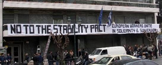 Greek trade unionist placing banner on EU offices in Athens