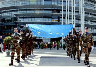 EAS troops about to raise the EU's flag