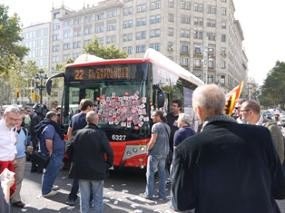 Strikers stop a scab bus with stickers in a general strike in Spain